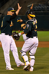 June 28, 2011; Oakland, CA, USA; Oakland Athletics relief pitcher Andrew Bailey (left) celebrates with catcher Kurt Suzuki (8) at the end of the game against the Florida Marlins at the O.co Coliseum. Oakland defeated Florida 1-0.