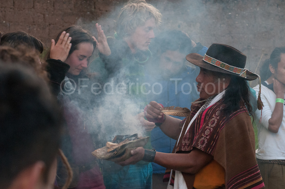 "The shaman Santiago Carhuacho during the opening ceremony of the  Pachamama Connections festival. A feature of the Sacred Valley, derived from his great energy, are the festivals in  between mysticism and  counterculture. Although the root is totally Andean  the audience is predominantly young and ""gringo""."