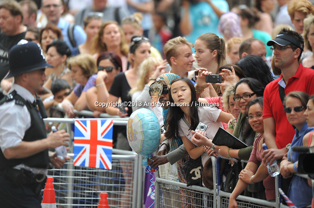 Members of the public are seen waiting outside St. Mary's hospital trying to get a glimpse as The Duke and Duchess of Cambridge and their newborn son are staying following the birth of the Royal baby,<br /> London, United Kingdom<br /> Tuesday, 23rd July 2013<br /> Picture by Andrew Parsons / i-Images