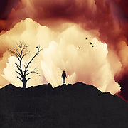 Man on a mountain range under an exploding sky - Photo illustration using my images, brushes and a variety of effects.<br />