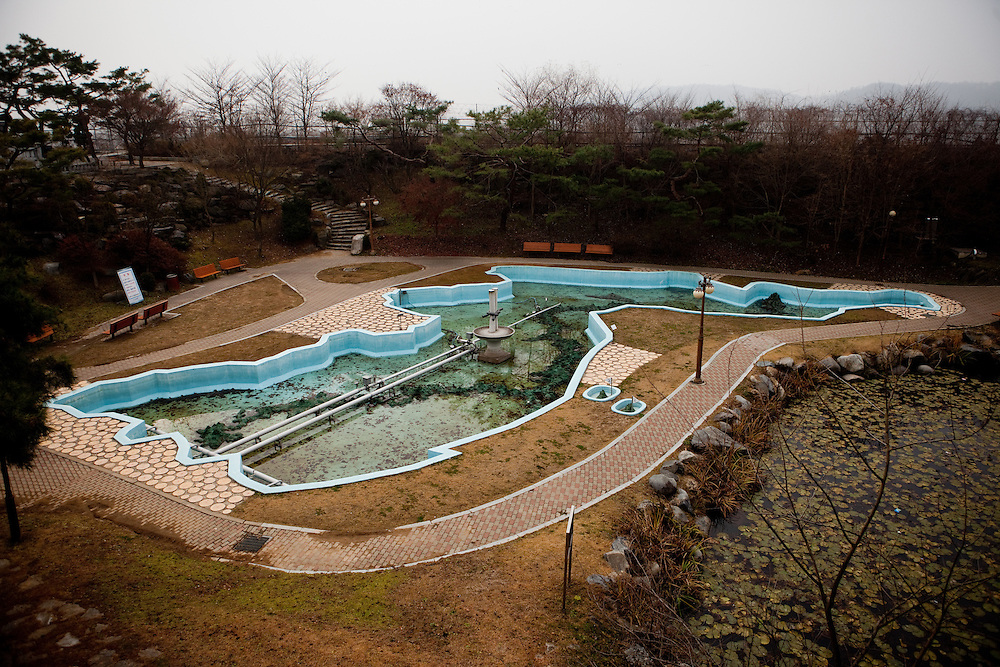 Imjingak/South Korea, Republic Korea, KOR, 28.11.2009: Empty swimming pool at Imjingak, located 7 km from the Military Demarcation Line, which is now at the forefront of tourism related to the Korean Conflict. It was built in 1972 with the hope that someday unification would be possible.