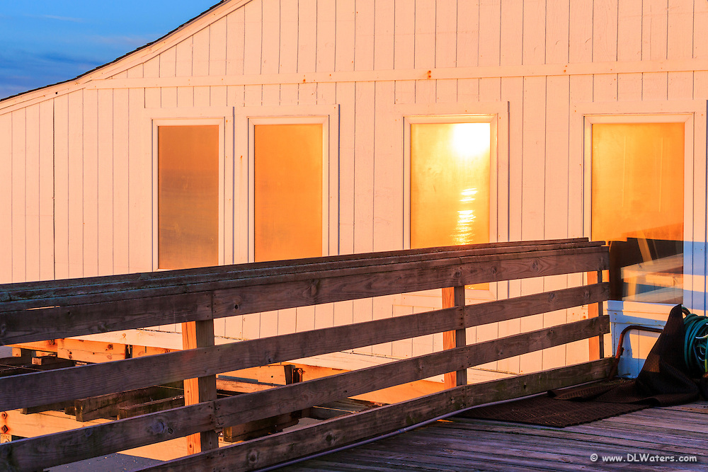 Sunrise reflected in the windows of Kitty Hawk Fishing Pier North Carolina.
