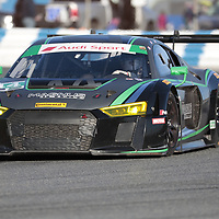 January 06, 2018 - Daytona Beach, Florida, USA:  The Magnus Racing Audi R8 LMS GT3 races through the turns at the Roar Before The Rolex 24 at Daytona International Speedway in Daytona Beach, Florida.