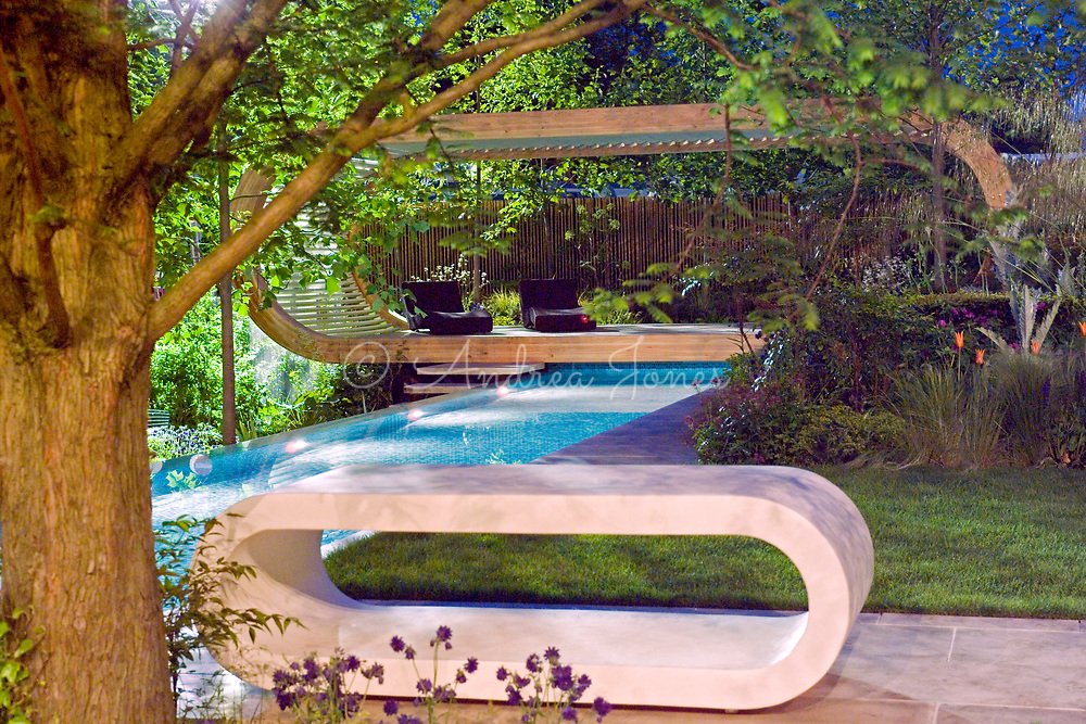 Infinity swimming pool with pavillion, jacuzzi, borders &amp; trees. Lighting. The Cancer Research UK Garden by Andy Sturgeon<br /> RHS Chelsea Flower Show 2006