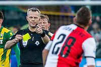 DEN HAAG - ADO Den Haag - Feyenoord , Voetbal , Eredivisie , Seizoen 2016/2017 , Kyocera Stadion , 19-02-2017 , Scheidsrechter Bjorn Kuipers (l) geeft geel aan Feyenoord speler Jens Toornstra (r)