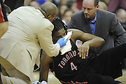 April 6, 2010; Cleveland, OH, USA; Toronto Raptors forward Chris Bosh (4) gets attention from team trainers after an injury during the first quarter against the Cleveland Cavaliers at Quicken Loans Arena. Mandatory Credit: Jason Miller-US PRESSWIRE