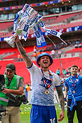 Tranmere Rovers midfielder James Norwood (10) holds the Play-off final cup after the EFL Sky Bet League 2 Play Off Final match between Newport County and Tranmere Rovers at Wembley Stadium, London, England on 25 May 2019.