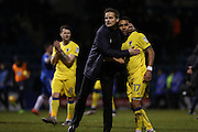 AFC Wimbledon manager Neal Ardley congratulates AFC Wimbledon striker Andy Barcham (17) for scoring the equalising goal during the EFL Sky Bet League 1 match between Gillingham and AFC Wimbledon at the MEMS Priestfield Stadium, Gillingham, England on 21 February 2017.