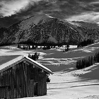 Monochrome Image of an Alpine Mountain Cabin in a Winter Landscape. Austria, Europe
