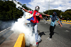 July 4, 2017 - Valencia, Carabobo, Venezuela - Young people from the resistance and police of Carabobo faced the distributor in the field, during the realization of the ''plantazo''. The police repressed the action of the Protestants who blocked the road, threw gas bleeding. The young men returned them and also both sides were attacked with stones. On the police side, detonations of unauthorized firearms were heard to suppress protests. Some people were affected by the gases, there were detainees and journalists were also attacked and robbed by the state police. In Valencia, Carabobo state. Photo: Juan Carlos Hernandez (Credit Image: © Juan Carlos Hernandez via ZUMA Wire)