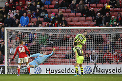Yeovil Town's Shane Duffy heads off the line - Photo mandatory by-line: Matt Bunn/JMP - Tel: Mobile: 07966 386802 14/12/2013 - SPORT - Football - Barnsley - Oakwell - Barnsley v Yeovil Town - Sky Bet Championship