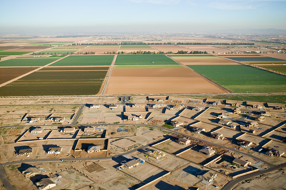 A new development spreads out over irrigated desert farmland.  The community gets water from a combination of groundwater and water diverted from the Colorado River.  Neighboring farms grow vegetables for export to other parts of the country.