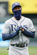 Tampa Bay Rays center fielder Desmond Jennings attempts to stay warm before a baseball game against the Kansas City Royals at Kauffman Stadium in Kansas City, Thursday, May 2, 2013. Game time temperatures are expected to be in the 30's.  (AP Photo/Colin E. Braley).