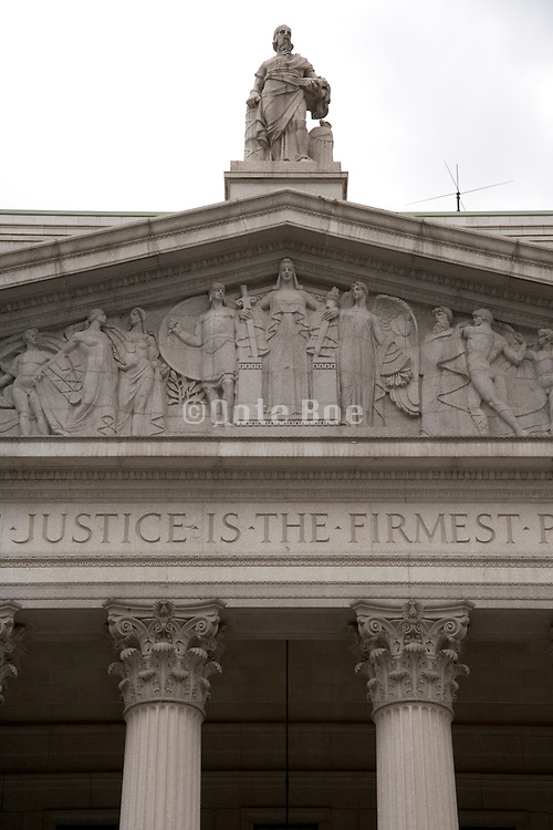 detail of the frieze above the entrance to court house in New York City