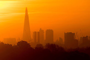 UNITED KINGDOM, London: 05 May 2016 The sun rises behind a London skyline this morning on yet another warm day. Temperatures are set to increase through to the weekend, reaching up to 25 degrees. Rick Findler / Story Picture Agency