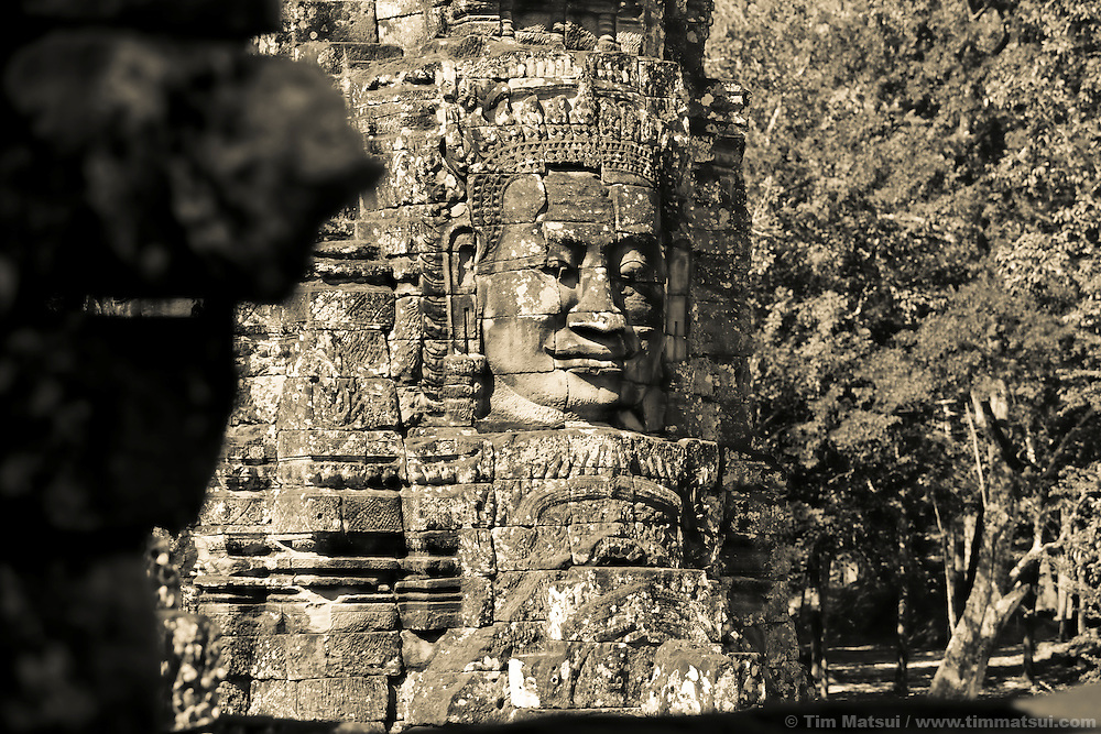 Stone faces adorn the ancient Bayon temple, part of the Angkor Wat complex in Siem Reap, Cambodia.