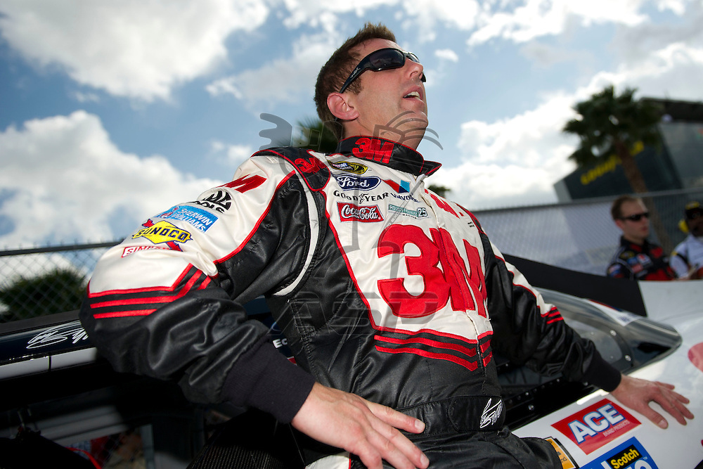 Daytona Beach, FL - FEB 19, 2012: Greg Biffle (16) gets out of the car during qualifying for the Daytona 500 at the Daytona International Speedway in Daytona Beach, FL.