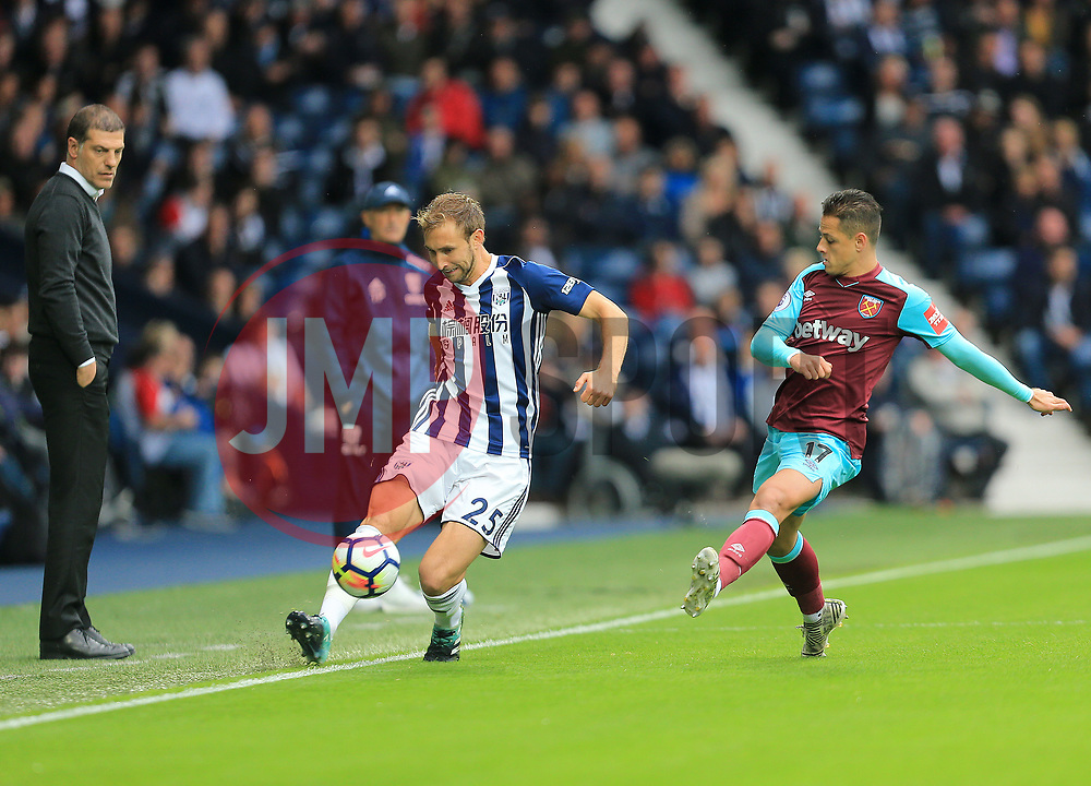 Craig Dawson of West Bromwich Albion keeps the ball in play as Javier Hernandez of West Ham United looks to close in - Mandatory by-line: Paul Roberts/JMP - 16/09/2017 - FOOTBALL - The Hawthorns - West Bromwich, England - West Bromwich Albion v West Ham United - Premier League