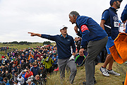 SOUTHPORT, ENGLAND - JULY 23: Jordan Spieth of the United States considers his options with Rules Officials on the 13th hole during the final round of the the 146th Open Championship at Royal Birkdale on July 23, 2017 in Southport, England. (Photo by Chris Condon/R&amp;A/R&amp;A/PGA TOUR via Getty Images)<br /> <br /> My first time covering the Open Championship was definitely not boring. Jordan Spieth hit his drive so far right on #13, it ended up on the side of a steep hill in deep grass. Here, he is pleadsing his case to a rules official to take his drop on the driving range. He got the drop, made an amazing shot, and went on to win the tournament.