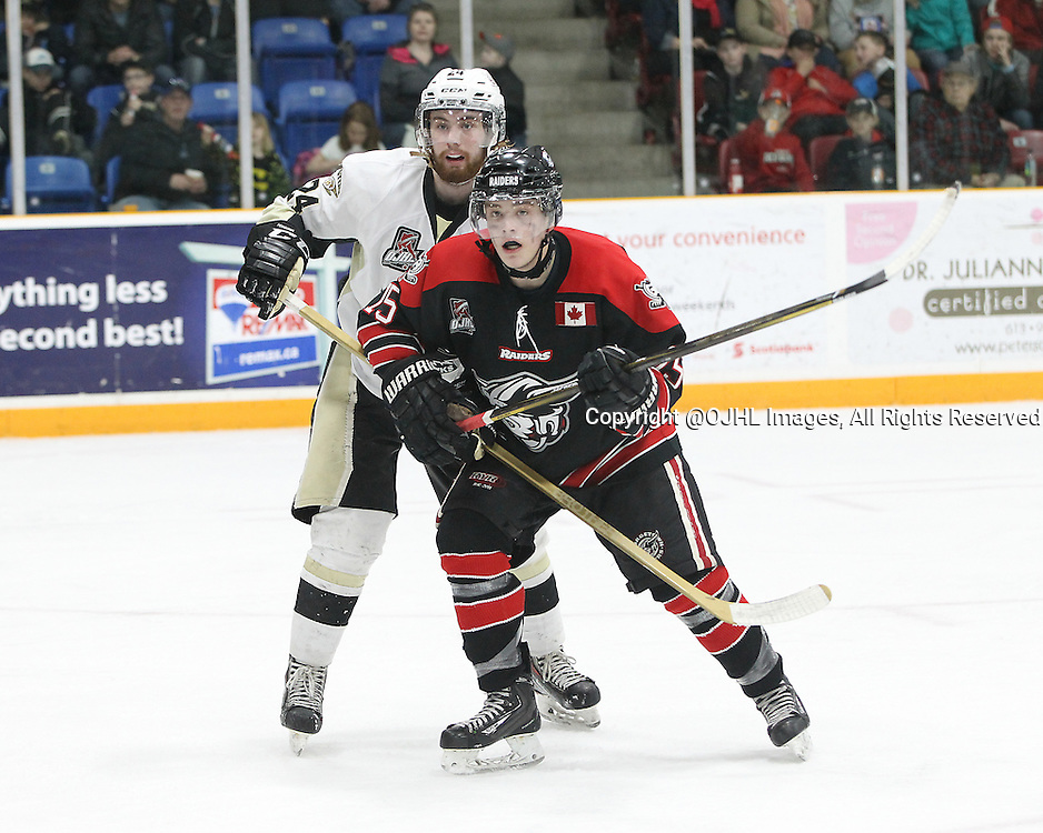 TRENTON, - Apr 15, 2016 -  Ontario Junior Hockey League game action between Trenton Golden Hawks and the Georgetown Raiders. Game 1 of the Buckland Cup Championship Series. At the Duncan Memorial Gardens, ON. Daniel Hardie #15 of the Georgetown Raiders and Jordan DaSilva #24 of the Trenton Golden Hawks follows the play during the third period.<br /> (Photo by Tim Bates / OJHL Images)
