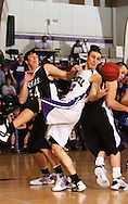 Cornell's Corey Dieser (22) grabs a rebound in front of Loras' Dan Pawelski (54) in the first half of their IIAC Tournament Semifinal game at Cornell College in Mount Vernon on Thursday February 26, 2009. Cornell won 65-60.