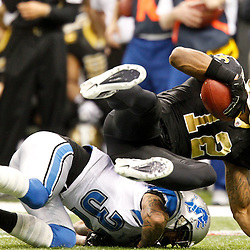 December 4, 2011; New Orleans, LA, USA; New Orleans Saints wide receiver Marques Colston (12) is tackled by Detroit Lions cornerback Aaron Berry (32) during the second quarter of a game at the Mercedes-Benz Superdome. Mandatory Credit: Derick E. Hingle-US PRESSWIRE
