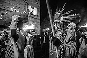 "Allendale Town, New Year's Eve 2017. Men are carrying burning barrels filled with tar, sawdust, kindling and paraffin on their heads.<br /> The Tar Barl Festival has been Allendale's way of welcoming the new year for at least 160 years.<br /> The normally quiet village heaves with people - locals, visitors and the barrel-carrying ""guisers"" wearing fancy dress or a disguise. <br /> A fiery procession swarms round the Northumberland village, returning to the square just before midnight to throw its barrels on to the waiting bonfire, setting it alight."
