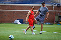 ANN ARBOR, USA - Friday, July 27, 2018: Liverpool's manager Jürgen Klopp gives new signing Xherdan Shaqiri a kick up the back-side during a training session ahead of the preseason International Champions Cup match between Manchester United FC and Liverpool FC at the Michigan Stadium. (Pic by David Rawcliffe/Propaganda)