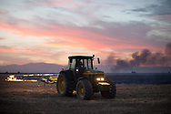 A farmer drives a tractor to make a firewall during a forest fire near El Cubillo de Uceda, on August 11, 2012 in Guadalajara, Spain. During a heat wave dozens of forest fires have appeared in Spain, three of them at National Parks, like Teide, Doñana or Cabañeros, and thousands of people had to be evacuated at La Gomera and Tenerife, in the Canary Islands.