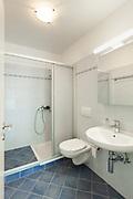 interior of an apartment, tiled bathroom