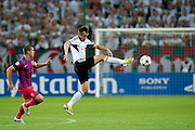 (R) Legia's Miroslav Radovic fights for the ball with (L) Steaua's Alexandru Bourceanu during the UEFA Champions League play-off second leg match between Legia Warsaw and FC Steaua Bucuresti at Pepsi Arena Stadium in Warsaw on August 27, 2013.<br /> <br /> Poland, Warsaw, August 27, 2013<br /> <br /> Picture also available in RAW (NEF) or TIFF format on special request.<br /> <br /> For editorial use only. Any commercial or promotional use requires permission.<br /> <br /> Photo by &copy; Adam Nurkiewicz / Mediasport