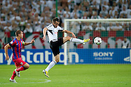 (R) Legia's Miroslav Radovic fights for the ball with (L) Steaua's Alexandru Bourceanu during the UEFA Champions League play-off second leg match between Legia Warsaw and FC Steaua Bucuresti at Pepsi Arena Stadium in Warsaw on August 27, 2013.<br /> <br /> Poland, Warsaw, August 27, 2013<br /> <br /> Picture also available in RAW (NEF) or TIFF format on special request.<br /> <br /> For editorial use only. Any commercial or promotional use requires permission.<br /> <br /> Photo by © Adam Nurkiewicz / Mediasport