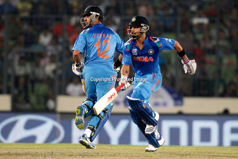Virat Kohli and Yuvraj Singh, ICC T20 cricket World Cup Final - Sri Lanka v India, Sher-e-Bangla National Cricket Stadium, Mirpur, Bangladesh, 6 April 2014. Photo: www.photosport.co.nz