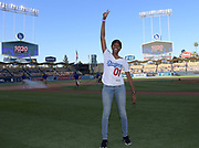 Jun 13, 2018; Los Angeles, CA, USA; Kyra Constantine poses before a MLB game between the Texas Rangers and the Los Angeles Dodgers at Dodger Stadium. Constantine ran the first  leg of the Southern California Trojans women's 4 x 400m relay team that won the NCAA title to clinch the national team championship.