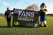 Haydon the Womble with Kick it out sign/ banner during the EFL Sky Bet League 1 match between AFC Wimbledon and Peterborough United at the Cherry Red Records Stadium, Kingston, England on 18 January 2020.