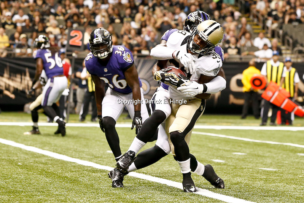 Aug 28, 2014; New Orleans, LA, USA; New Orleans Saints running back Travaris Cadet (39) scores a touchdown past Baltimore Ravens linebacker C.J. Mosley (57) during the first quarter of a preseason game at Mercedes-Benz Superdome. Mandatory Credit: Derick E. Hingle-USA TODAY Sports