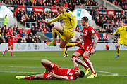 Bristol City defender Bailey Wright (42) dispossesses Burton Albion striker Cauley Woodrow (12) during the EFL Sky Bet Championship match between Bristol City and Burton Albion at Ashton Gate, Bristol, England on 4 March 2017. Photo by Richard Holmes.
