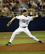 Twins relief pitcher Jason Miller turns towards home during the May 2007 game against the Chicago White Sox in the Metrodome.