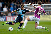 Wycombe Wanderers midfielder Max Kretzchmar (17) is tackled by Sam Muggleton of Barnet FC during the Sky Bet League 2 match between Wycombe Wanderers and Barnet at Adams Park, High Wycombe, England on 16 April 2016. Photo by Dennis Goodwin.