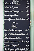 Traditional French Cafe menu of Entrees and Plats in quaint town of Castelmoron d'Albret in Bordeaux region, Gironde, France