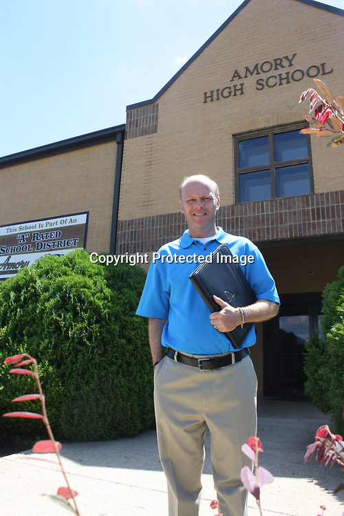 JOHN WARD/MONROE JOURNAL <br /> Amory High School Principal Brian Jones stands at the school's entrance. Jones was recently appointed as superintendent of the Webster County School District and will assume his new duties there in July.