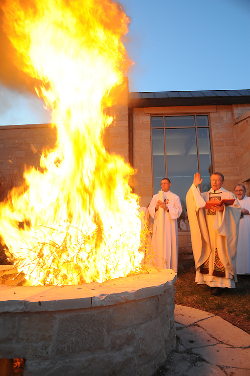 Norbertine Fr. Tim Shillcox begins the Easter Vigil Mass with a blessing of fire before lighting the Easter candle outside of Our Lady of Lourdes Church in De Pere, Wis. (Sam Lucero photo)