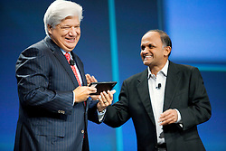 RIM President and Co-Chief Executive Officer Mike Lazaridis, (L), laughs with Adobe Chief Executive Officer Shantanu Narayen, as he announces the new BlackBerry PlayBook tablet during his keynote address at the BlackberryDevCon 2010  in San Francisco.