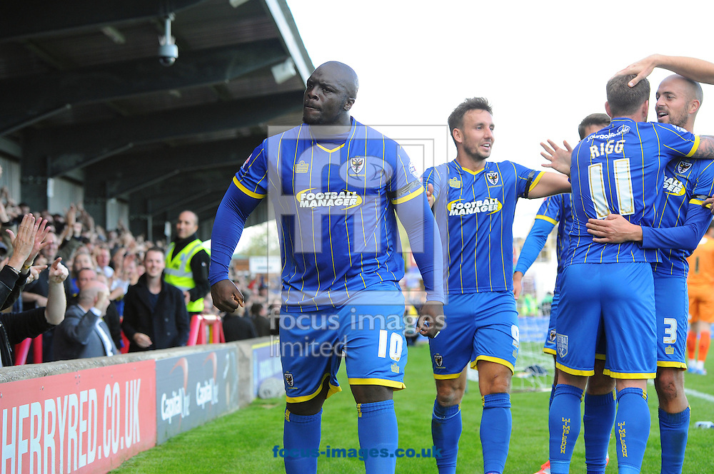 Adebayo Akinfenwa of AFC Wimbledon celebrates after scoring his, and his team's second goal during the Sky Bet League 2 match at the Cherry Red Records Stadium, Kingston<br /> Picture by Seb Daly/Focus Images Ltd +447738 614630<br /> 11/10/2014