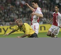 Thomas Vermaelan and Fredrik Ljungberg.<br />Photo: Barry Bland.<br />Ajax v Arsenal. UEFA Champions League.<br />27/09/2005.