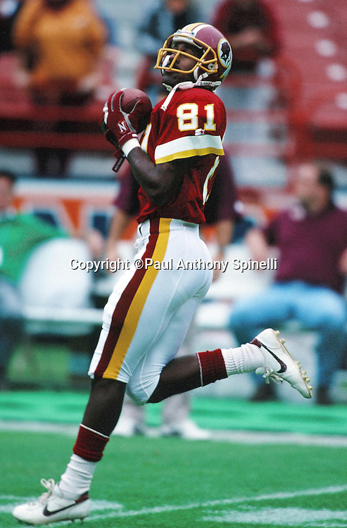 Washington Redskins wide receiver Art Monk (81) catches a pass while warming up before the NFL football game against the Los Angeles Rams on Nov. 21, 1993 in Anaheim, Calif. The Rams won the game 10-6. (©Paul Anthony Spinelli)