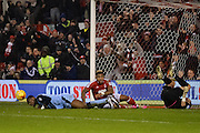 Rotherham United goalkeeper Richard O'Donnell (18) on his back after Nottingham Forest forward Britt Assombalonga (9) after scoring Forest's second goal to make it 2-0 during the EFL Sky Bet Championship match between Nottingham Forest and Rotherham United at the City Ground, Nottingham, England on 31 January 2017. Photo by Jon Hobley.