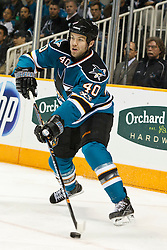 November 9, 2010; San Jose, CA, USA;  San Jose Sharks defenseman Kent Huskins (40) clears the puck against the Anaheim Ducks during the first period at HP Pavilion. Mandatory Credit: Jason O. Watson / US PRESSWIRE