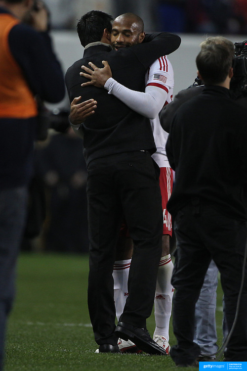 Thierry Henry, New York Red Bulls, and coach Mike Petke, embrace after substitution late in the game during the New York Red Bulls V Chicago Fire, Major League Soccer regular season match at Red Bull Arena, Harrison, New Jersey. USA. 27th October 2013. Photo Tim Clayton