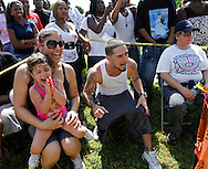 "Sandy Ogaza with her daughter Jolee Rivero, 3, and Jorge Guerra at right, cheer on the fighters on September 18, 2010. Dhafir Harris, ""Dada 5000"", puts on backyard fights at his mother house, which go viral on youtube and have been the subject of documentaries. Sometimes the men fight until they are unconscious. There' s no gloves and occasionally, there's a cage. The community has taken to the events, because they are able to set up businesses selling food and washing cars."